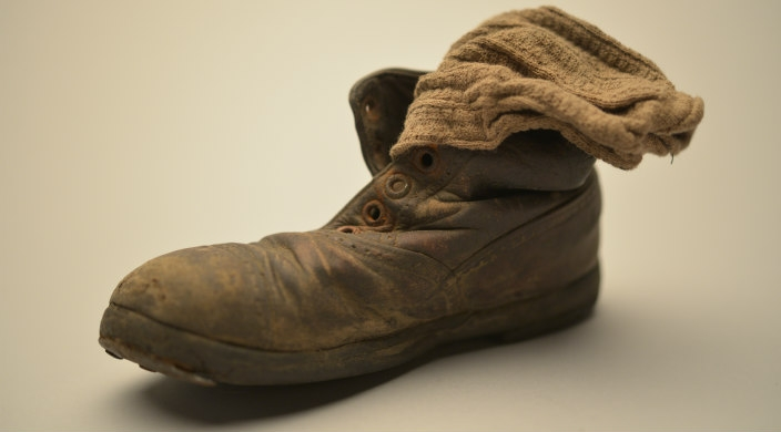 A child's shoe and sock from the museum exhibit
