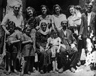 A photograph of the Veseli family posing with two Jewish families they sheltered and saved during WWII