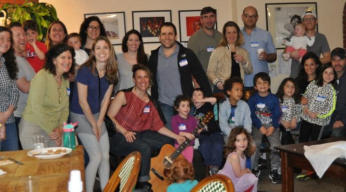 Parents and children at a community Tot Shabbat program