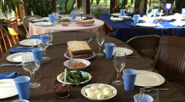 Seder table with more than a dozen place settings