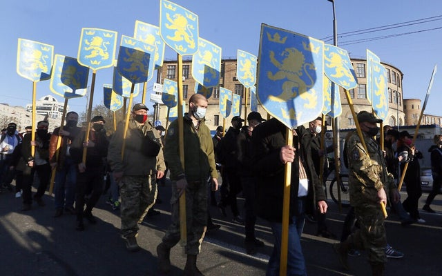 Hundreds in Ukraine attend marches celebrating Nazi SS soldiers