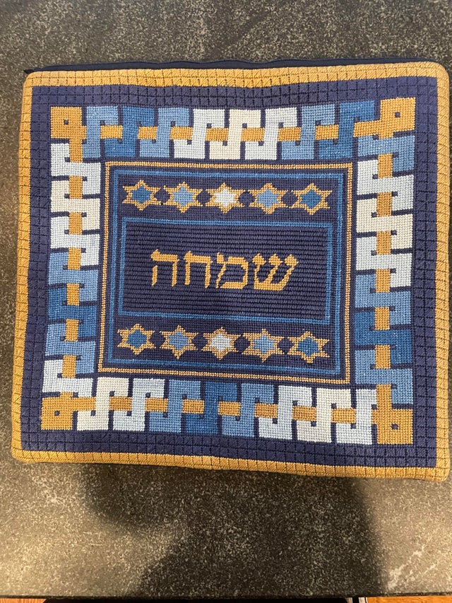 When I turned 5, my grandma started needlepointing a bag for my tallis. Twelve years later, here's the final product.