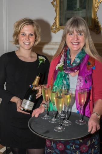 (l-r) Alice Randle and Rosey Fergusson-Taylor of Savills offering champagne to the guests.