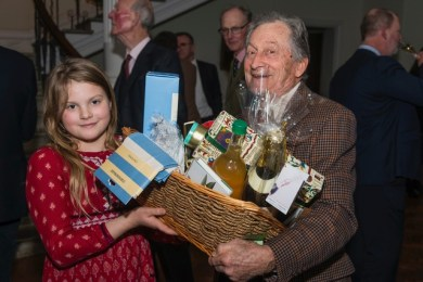 Gee Ashworth helps her grand-father, John Ashworth, winner of one of the main raffle prizes.