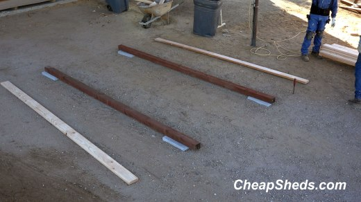 Simple pressure treated wood skids on concrete blocks