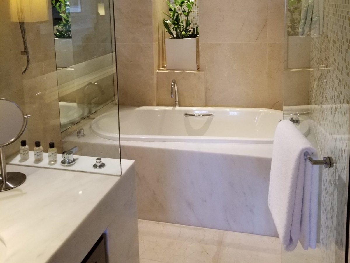 View of bathroom focused on large bathtub