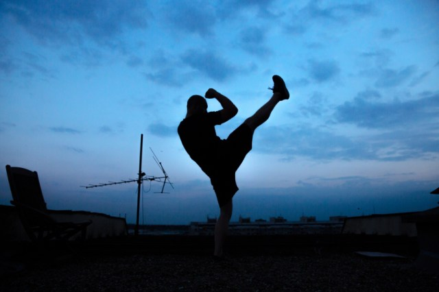 Man doing a high kick