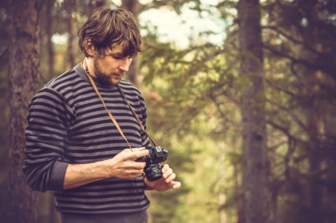 man taking photos of the sights in an under-the-radara national park instead of one of the more crowded U.S. national parks