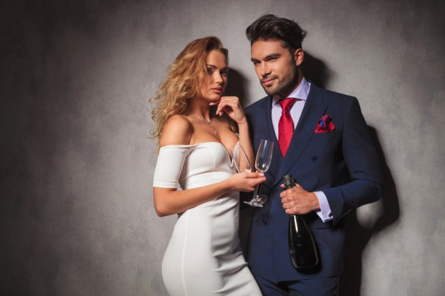 couple flirting and drinking wine