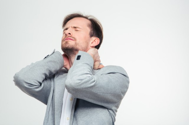 a man whose neck hurts