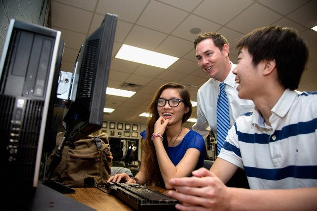 A high school teacher instructs members of Generation Z