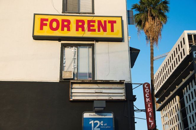 """a """"for rent"""" sign on an apartment"""