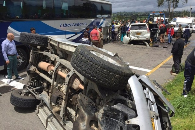 "Riot police officers and other people assist the governor of Boyaca, Carlos Amaya (in vehicle), after a road accident between the cities of Tunja and Duitama, Boyaca Department, Colombia, on July 12, 2016. According to a statement released by Boyaca' Government press office citing witnesses, his caravan collided with ""obstacles put in the way by striking truck drivers. / AFP / Edwin Camargo (Photo credit should read EDWIN CAMARGO/AFP/Getty Images)"