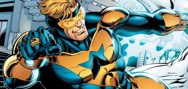 Booster Gold, smiling and jumping to the left of the frame