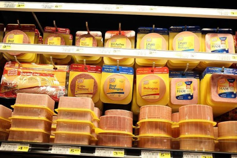 Processed meats are displayed in a grocery store
