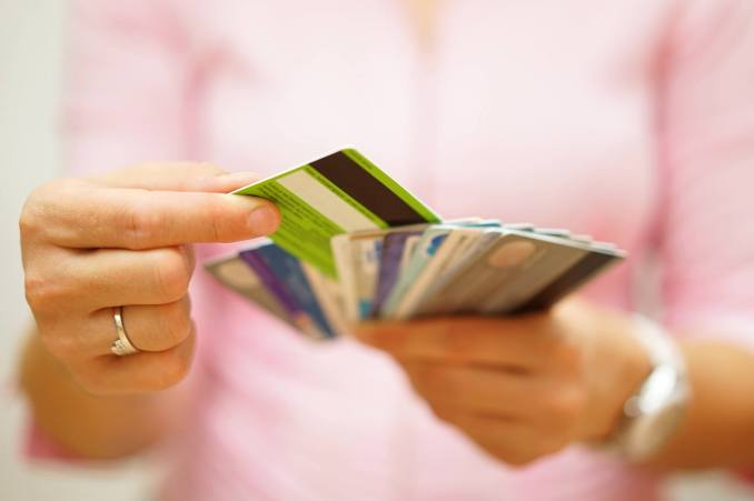 woman choose one credit card from many