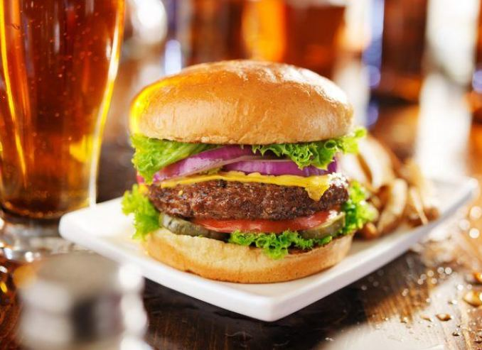 Cheeseburger with fries and beer.