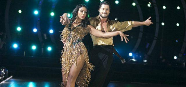 Tamar Braxton and Val Chmerkovskiy are dancing in gold outfits on 'Dancing with the Stars.'