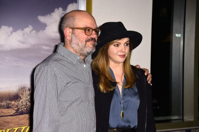 David Cross smiling, with his arm around Amber Tamblyn.