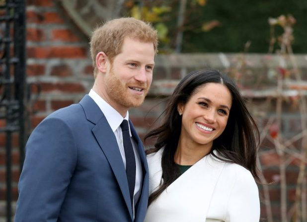 Prince Harry and actress Meghan Markle during an official photocall to announce their engagement on November 27, 2017 at The Sunken Gardens at Kensington Palace in London, England.  Prince Harry and Meghan Markle are officially couples since November 2016 and are due to marry in spring 2018.