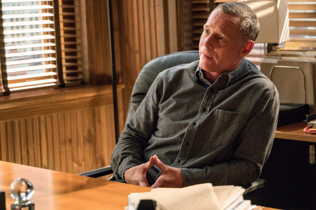 Jason Beghe as Sgt.  Hank Voight on 'Chicago PD' sitting at a desk