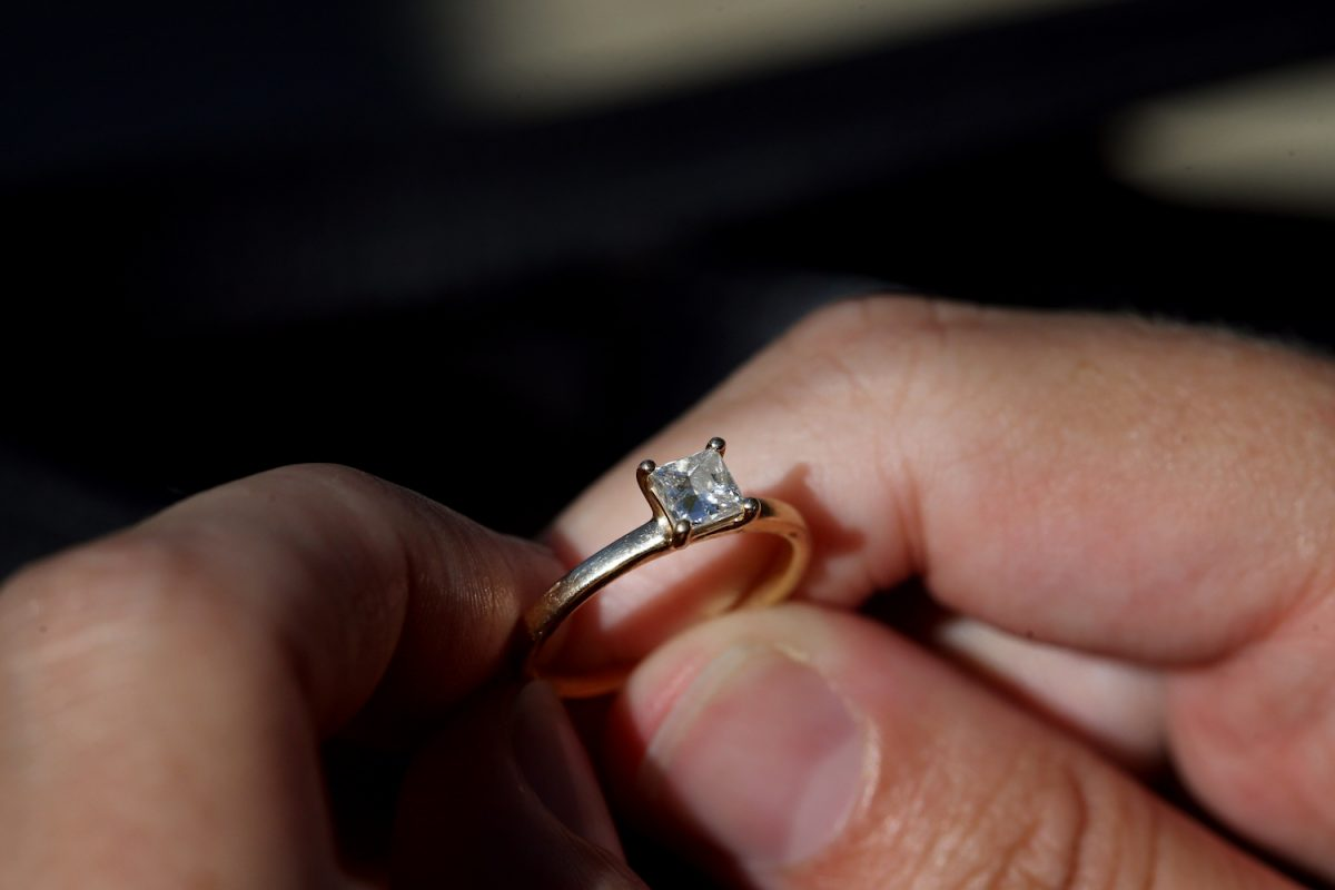 hands holding promise ring