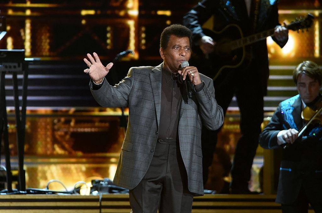 Charley Pride singing on stage