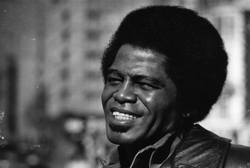 James Brown smiling in black and white photo