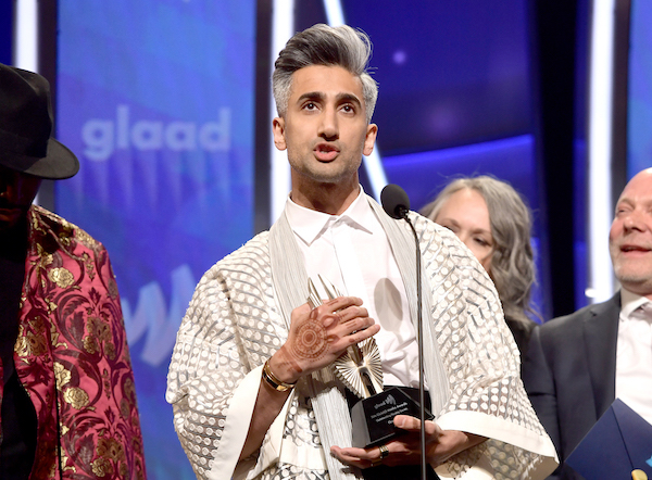 Tan France embraces the Special Reality Program for 'Queer Eye' on stage during the 30th Annual GLAAD Media Awards
