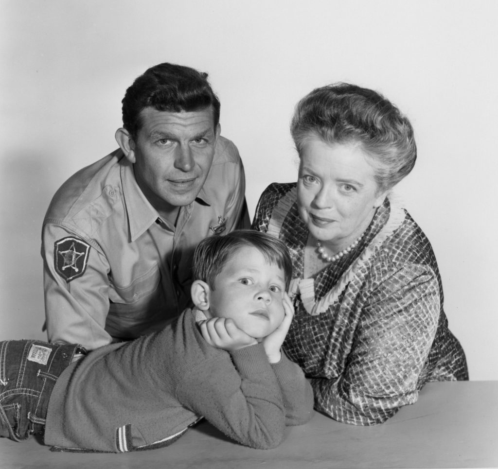Andy Griffith, Ron Howard, and Frances Bavier near a counter