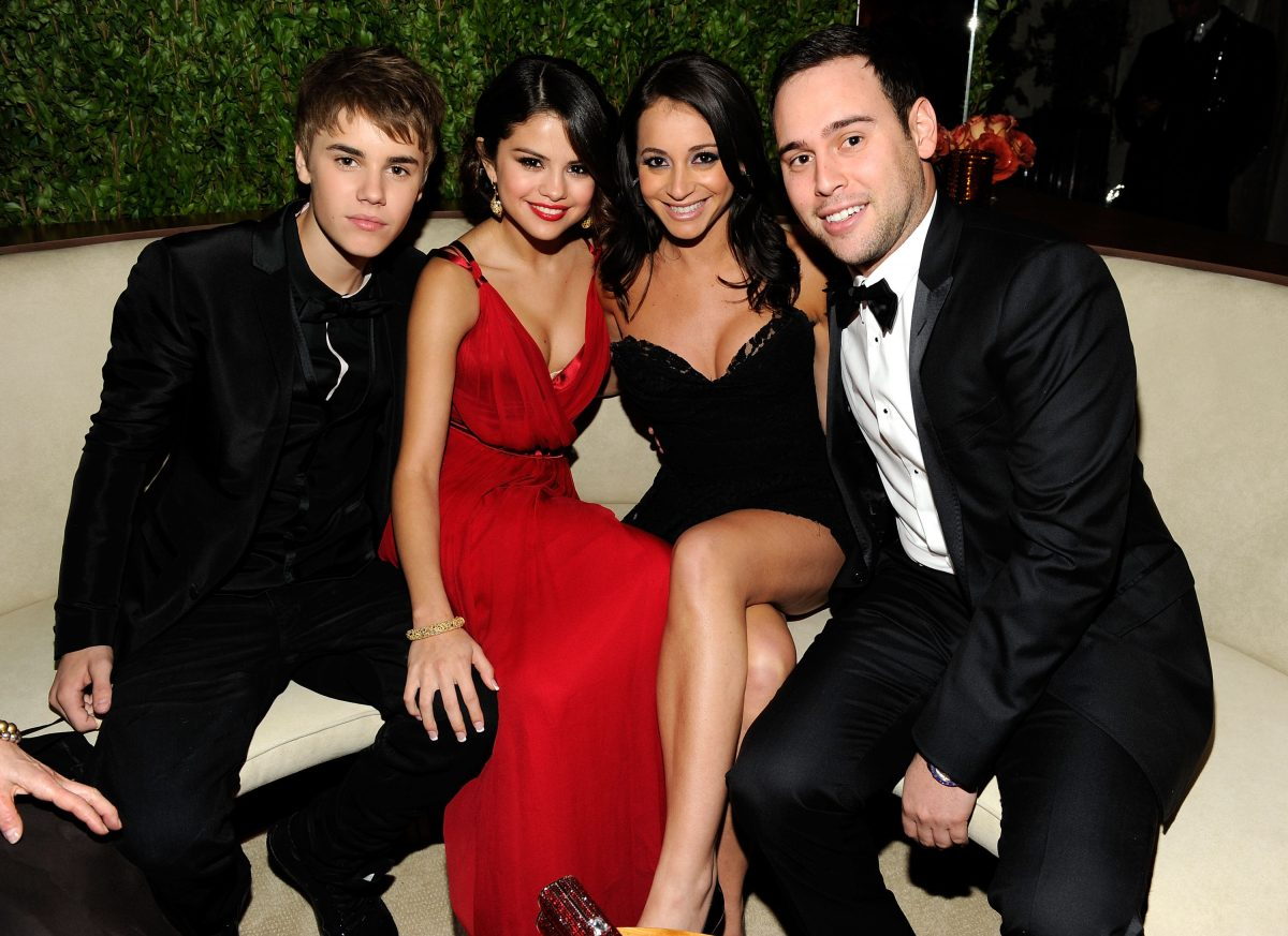 Justin Bieber, Selena Gomez, guest, and Scooter Braun will attend the 2011 Vanity Fair Oscar Party on February 27, 2011, in West Hollywood, California.