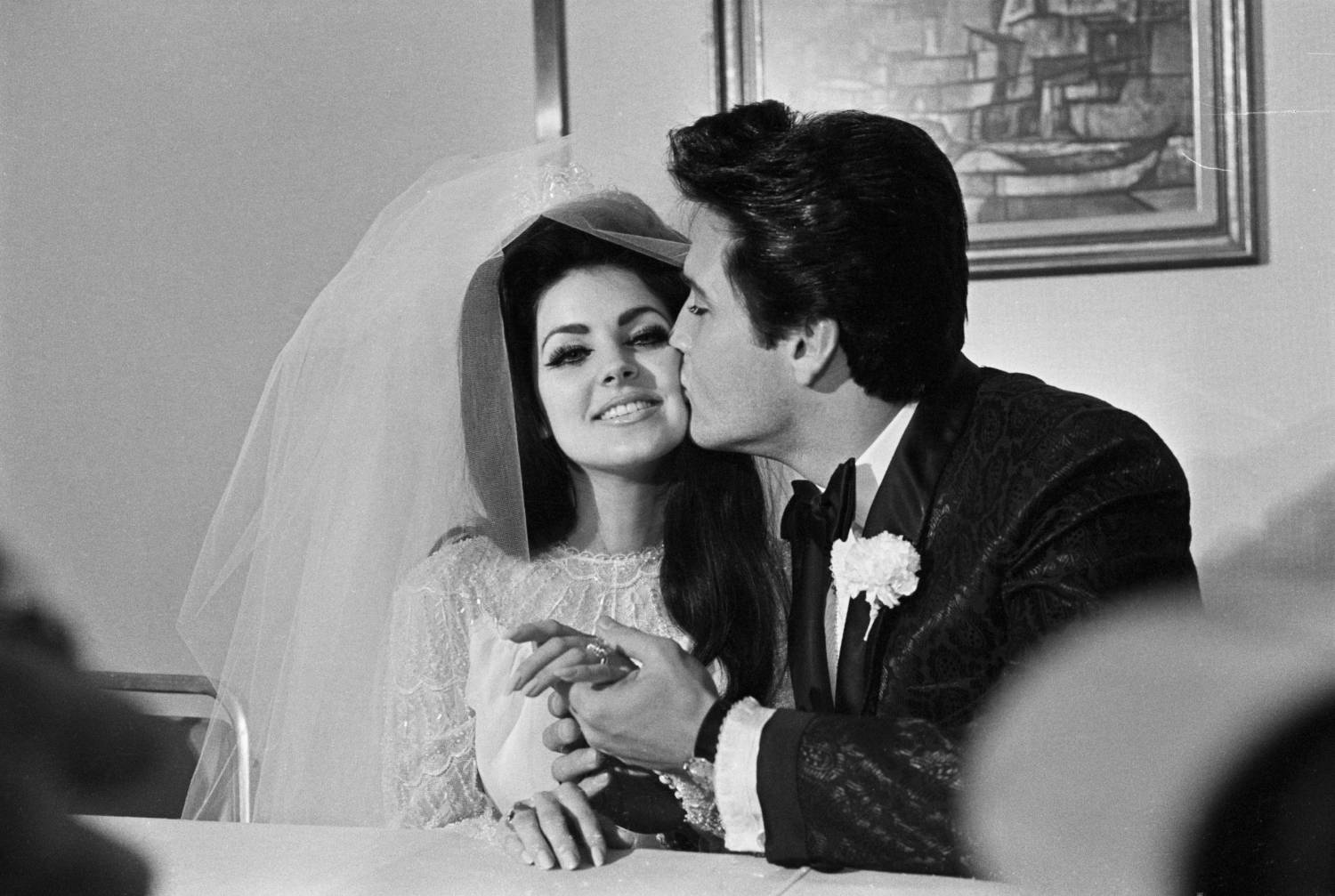 Las Vegas, NV: Elvis Presley will kiss his new bride, Priscilla Ann Beaulieu after their wedding.  The bride wears a large diamond on her finger.