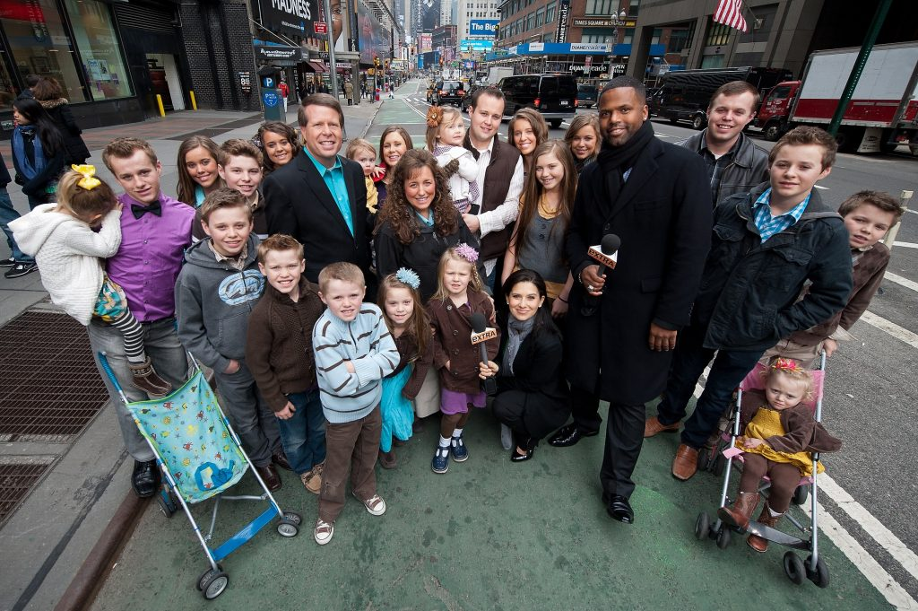 AJ Calloway and Hilaria Baldwin are standing with the Duggar family