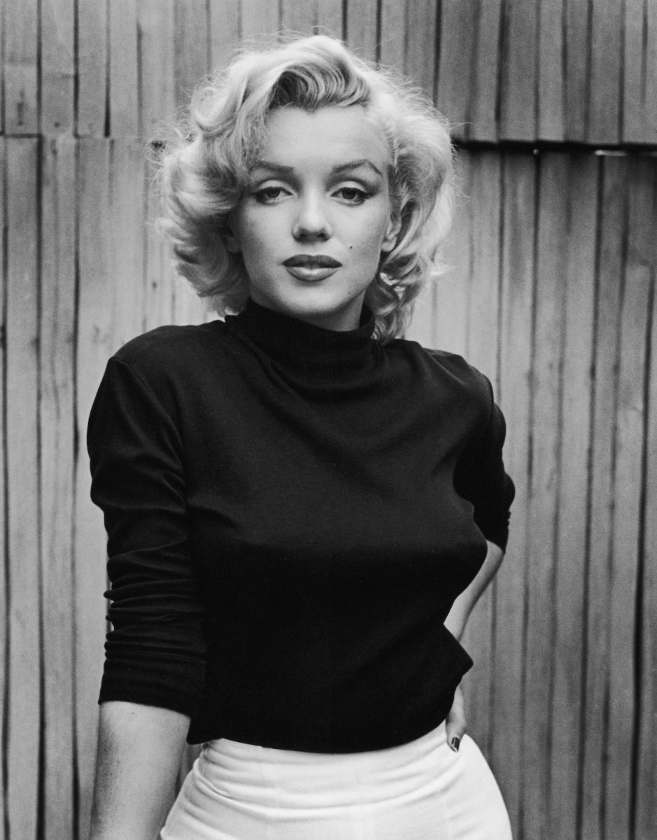 Marilyn Monroe on the patio of the home.  1953