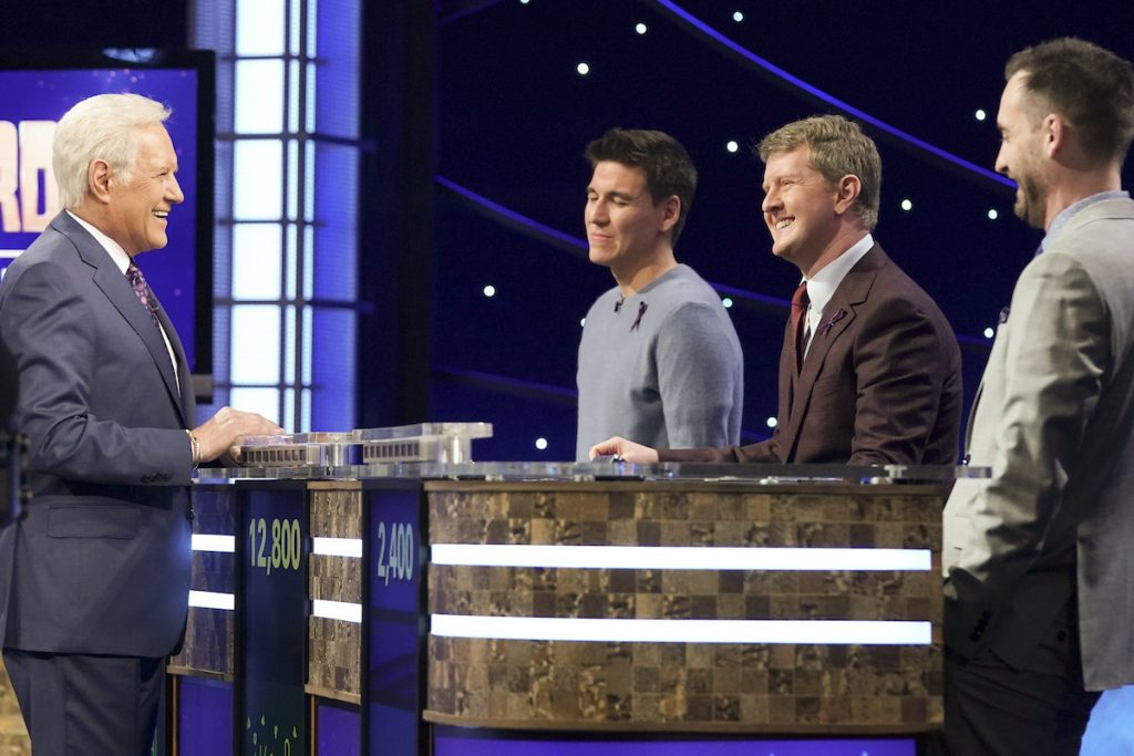 Alex Trebek chats with James Holzhauer, Ken Jennings, and Brad Rutter at the Champions League