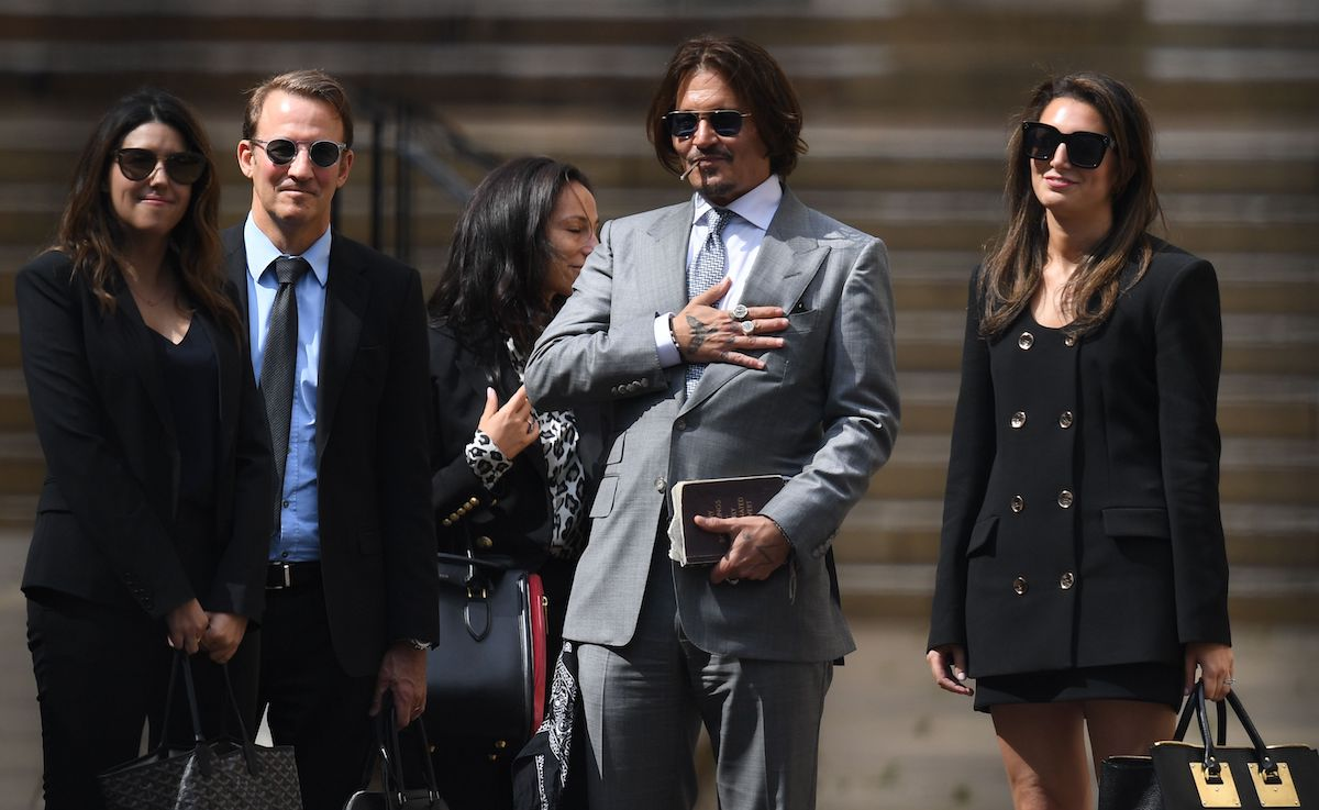 Johnny Depp leaves with members of his team including lawyer Adam Waldman