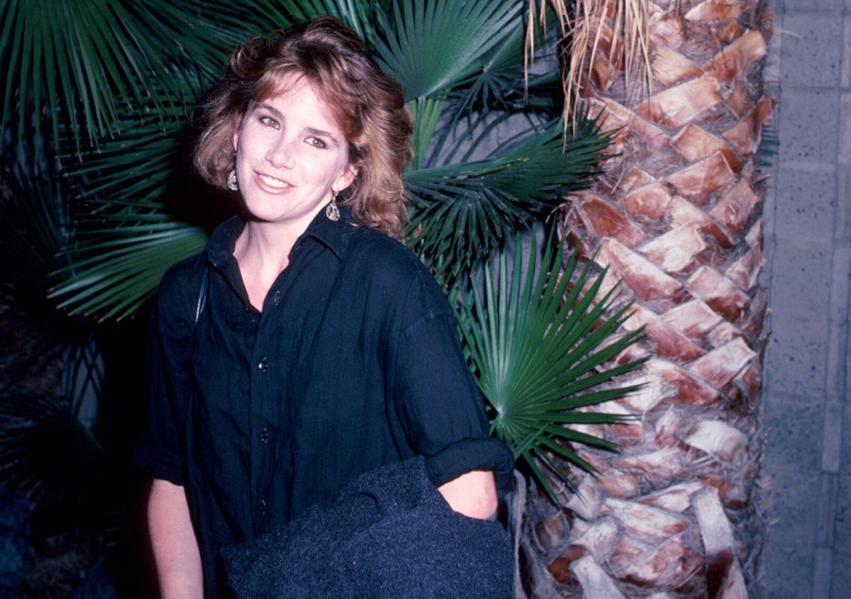 Melissa Gilbert in front of palm trees