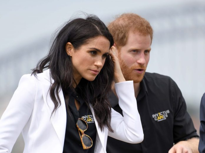 Prince Harry and Meghan Markle photographed together at the Invictus Games in Sydney, Australia