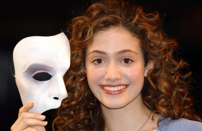 Amy Rosum holding a mask