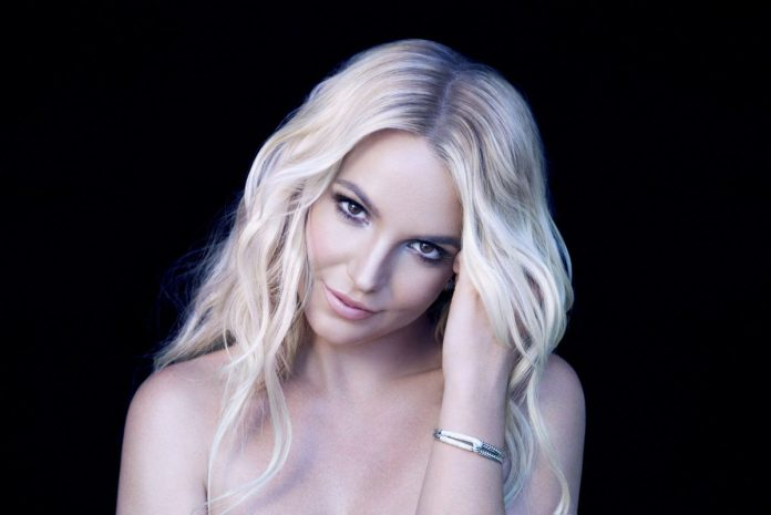 Britney Spears in front of a black background