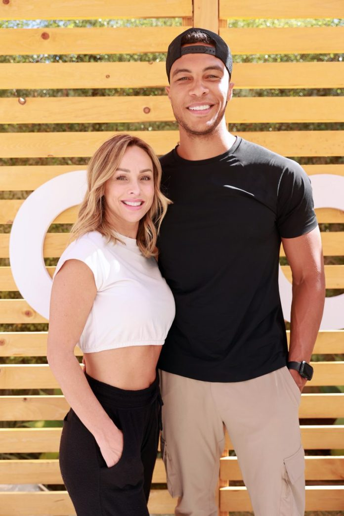 Claire Crowley and Del Moss from 'The Bachelorette' smiling at the camera with their arms around each other