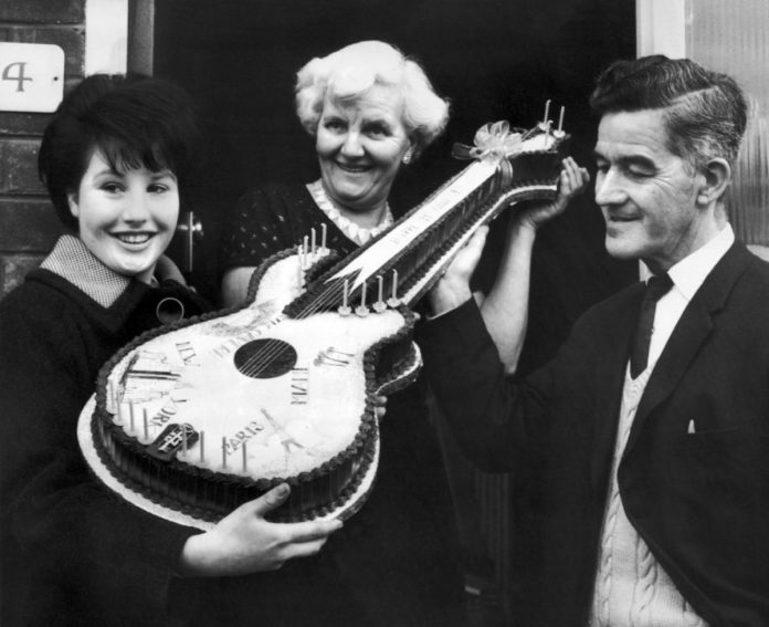 Lewis and Harold Harrison with a Beatles fan in 1964.
