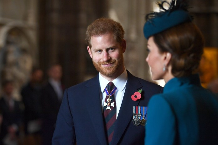 Prince Harry smiling at Kate Middleton during the ANZAC Day Service of Memorial and Thanksgiving