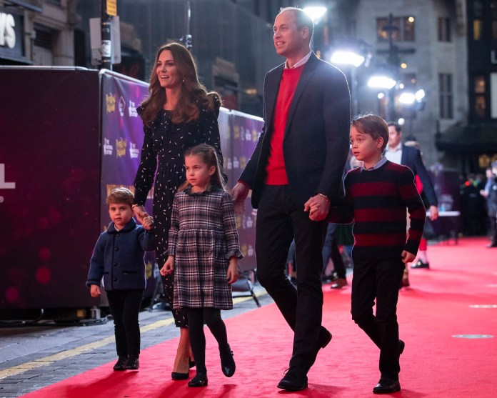 Prince William and Kate Middleton with their children on the red carpet for a special pantomime performance at the Palladium Theater in London