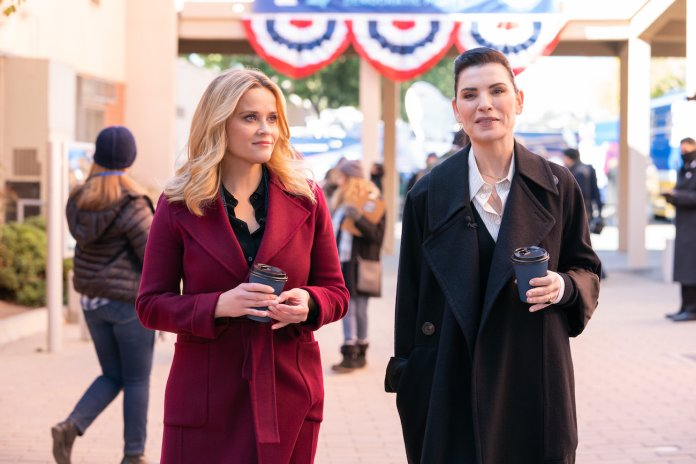 Reese Witherspoon and Julianna Margulies walk next to each other holding coffee cups in a scene from 'The Morning Show' Season 2