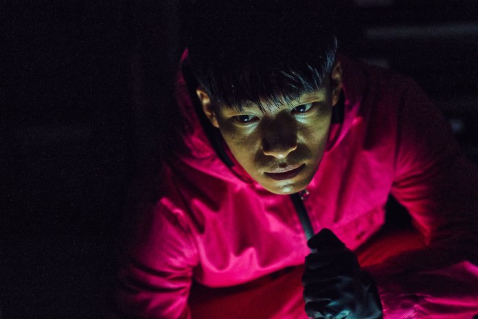 Wi Ha-jun wore a red jumpsuit from 'Squid Game'.