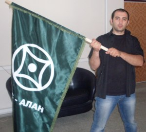 Alibek holding his flag