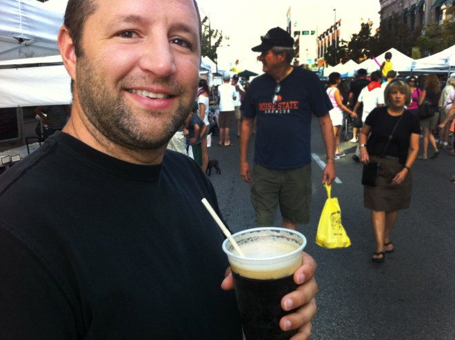 Dennis drinking Home Brew Root Beer at the Capital City Market, Boise, Idaho