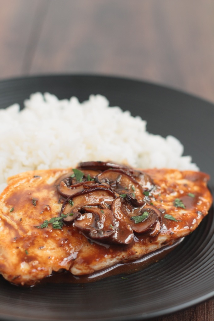 Balsamic Chicken with Mushrooms and Thyme: Tender chicken breasts are sautéed with a decadent sauce of aged balsamic and succulent mushrooms. All this in less than 20 minutes; perfect for a weeknight dinner.