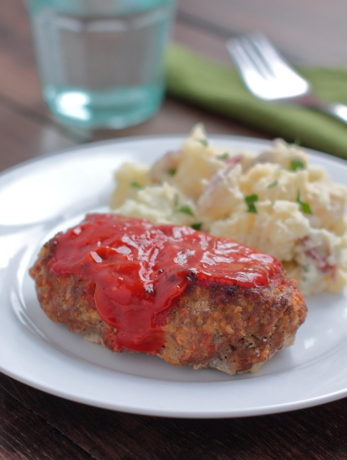 These mini meatloaves are made on a broiler sheet instead of in a muffin pan so everyone gets a tasty browned one instead of a pasty steamed one.